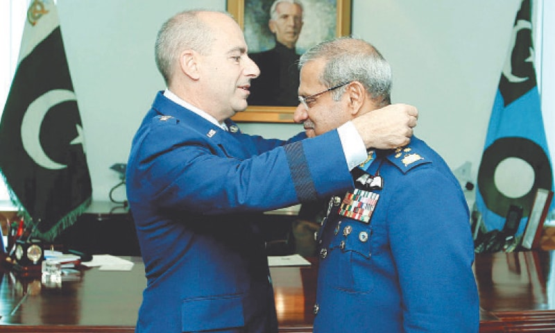 ISLAMABAD: Chief of the Air Staff Air Chief Marshal Sohail Aman being awarded Legion of Merit award by Lieutenant General Jeffrey L. Harrigian, Commander of US Air force Central Command, during a ceremony at the PAF headquarters on Monday.—PPI