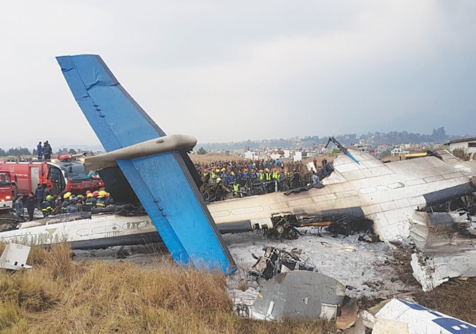 KATHMANDU (Nepal): Photo shows the wreckage of the plane after it crashed near the runway and skidded into a football field.—INP