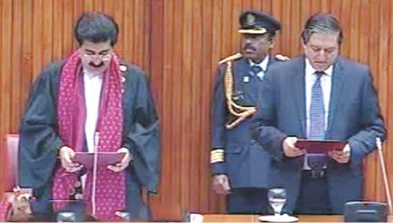NEWLY elected Senate Chairman Sadiq Sanjrani administering the oath to deputy chairman Saleem Mandviwalla on Monday.
