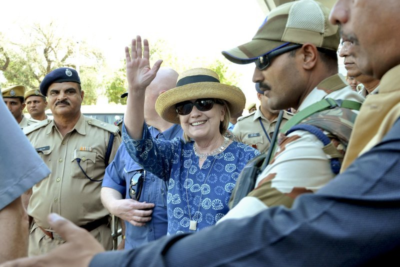 Former US Secretary of State Hillary Clinton center waves as she comes out of the Jodhpur airport upon her arrival in Jodhpur Rajasthan state India on Tuesday. — AP
