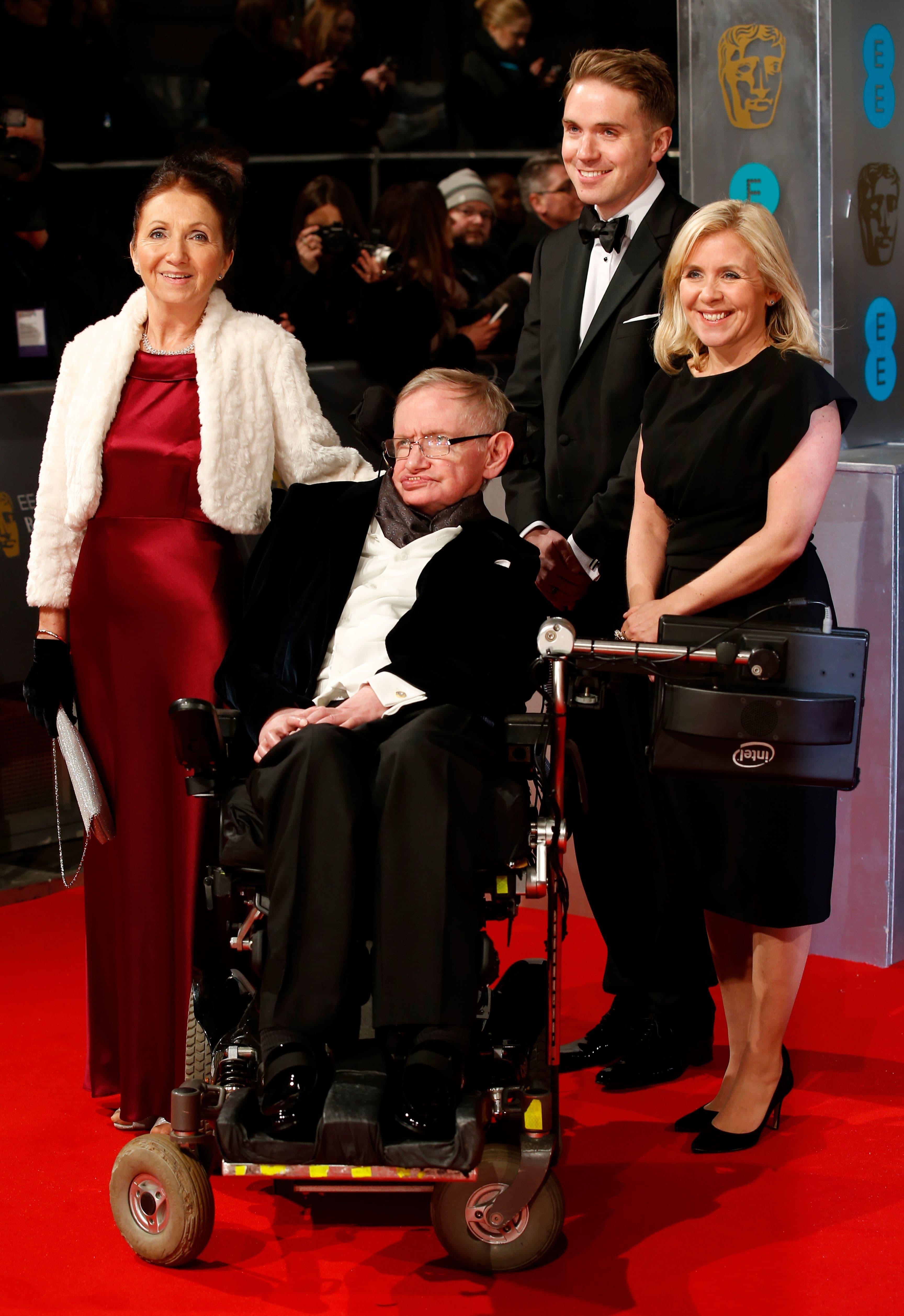Hawking arrives on the red carpet with former wife Jane Hawking (L) and daughter Lucy Hawking (R) for the BAFTA British Academy Film Awards at the Royal Opera House in London. A film based on Jane's memoir about Hawking called *The Theory of Everything* was nominated for various awards in 2014. — AFP
