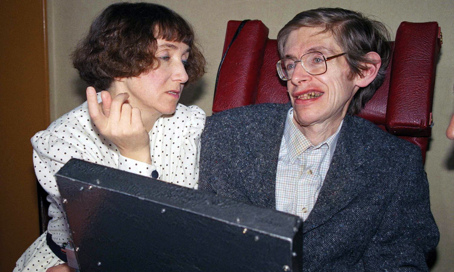 In this March 3, 1989 file photo British astrophysicist Dr. Stephen Hawking, 47, answers newsmen with the help of his computer and the assistance of his then wife Jane, in Paris. — AP