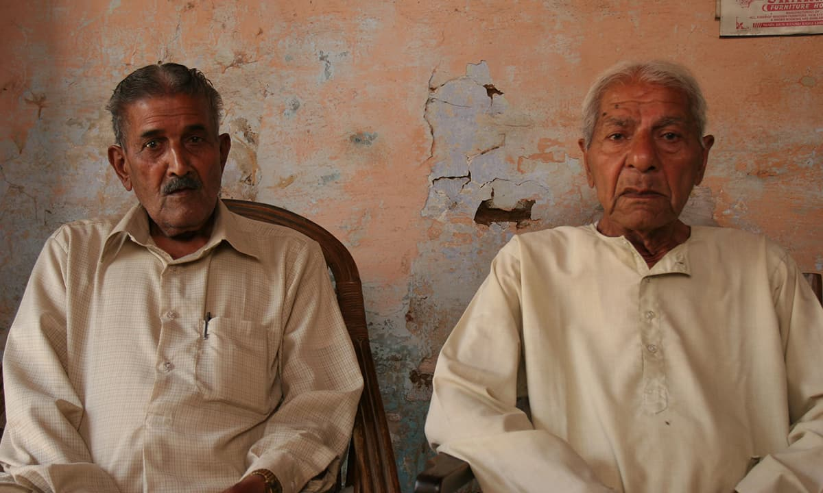 Pundit Fakir Chand Sangar (left) , who remembers Rashid's grandfather, with his brother in Ughi