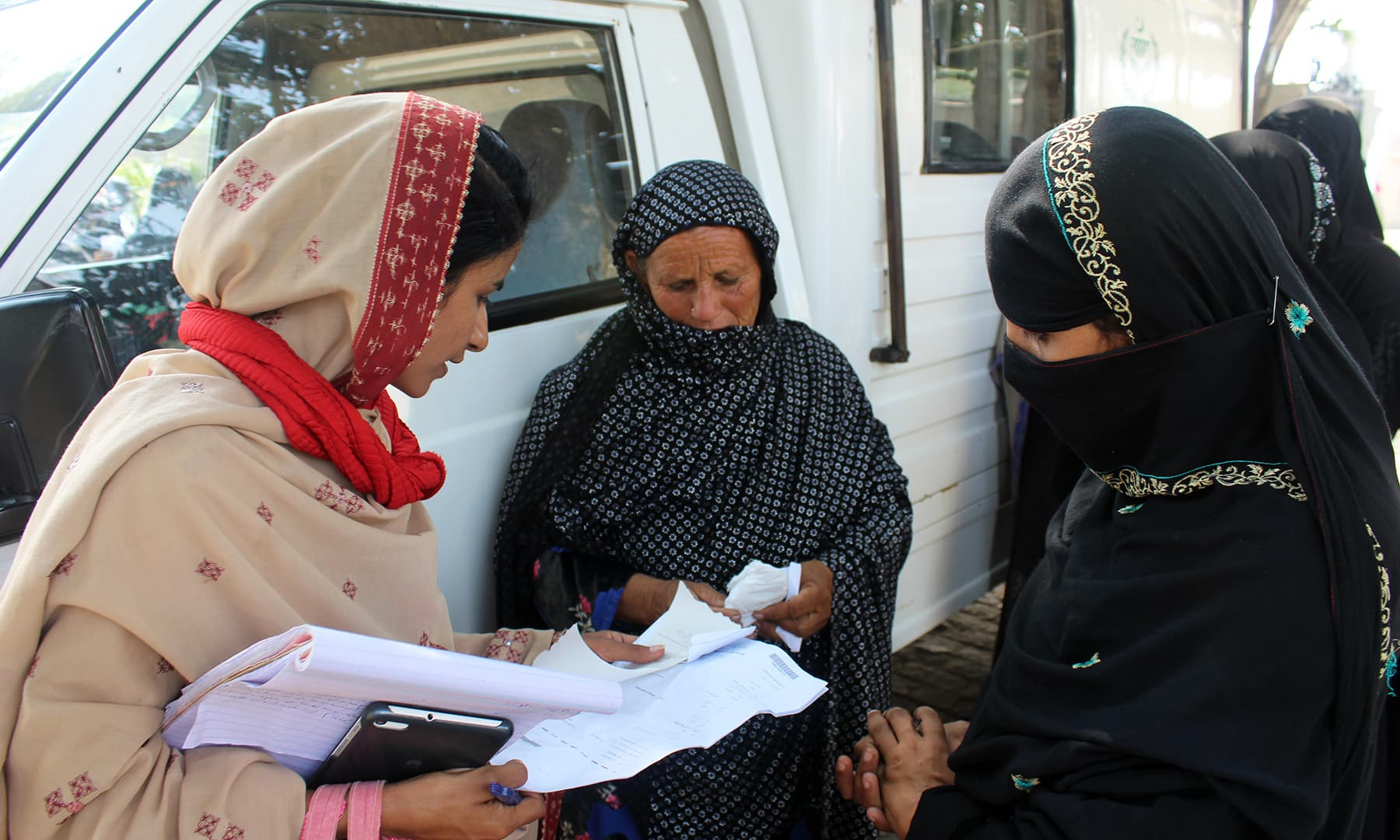 A social activist guiding women on how to get a CNIC made. — Photo by author