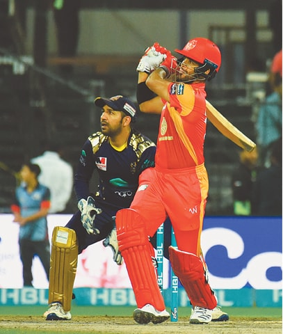 ISLAMABAD United opener J.P. Duminy plays a stroke  as Quetta Gladiators' captain Sarfraz Ahmed looks on during their PSL match at the Sharjah Cricket Stadium. —Courtesy PCB