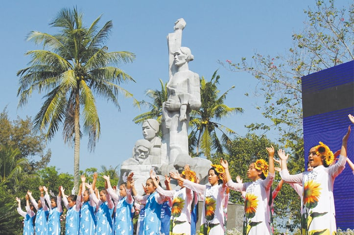 CHILDREN perform at a war memorial dedicated to the victims of the My Lai massacre in the village of Son My during a ceremony marking the 50th anniversary of the massacre on March 16. The killings on March 16, 1968 that left 504 villagers dead — mostly unarmed women, children and older men in one of the Vietnam War's worst atrocities — were later uncovered by US investigative reporter Seymour Hersh and polarised public opinion and energised a mounting anti-war movement in the US.—AFP