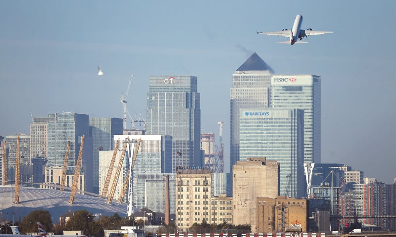 London: A British Airway airplane climbs after taking off at London City Airport on Oct 27, 2017. Britain's top businesses are cranking their Brexit plans into gear, shifting operations abroad to ensure a smooth transition when the nation quits the European Union in one year's time. A swathe of big-hitting financial institutions, including HSBC, UBS and JPMorgan and Morgan Stanley, have confirmed plans to move some activities to Paris, as well as to Amsterdam, Dublin and Frankfurt.—AFP