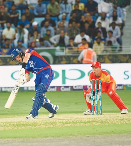 DUBAI: Karachi Kings' batsman Joe Denly plays a shot as Islamabad United wicketkeeper Luke Ronchi looks on during the first playoff of the Pakistan Super League at Dubai Cricket Stadium on Sunday.—Courtesy PCB