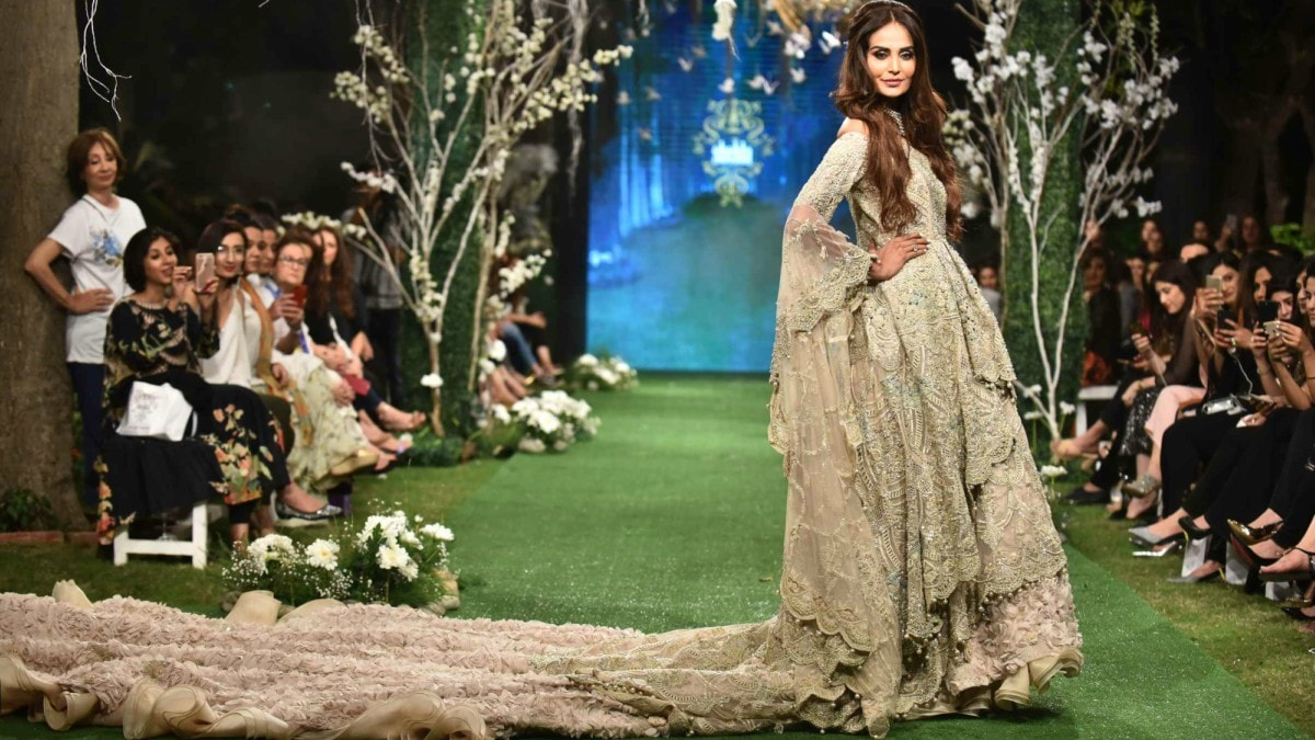 Showstopper Mehreen Syed carried her ensemble's heavy trail with a smile