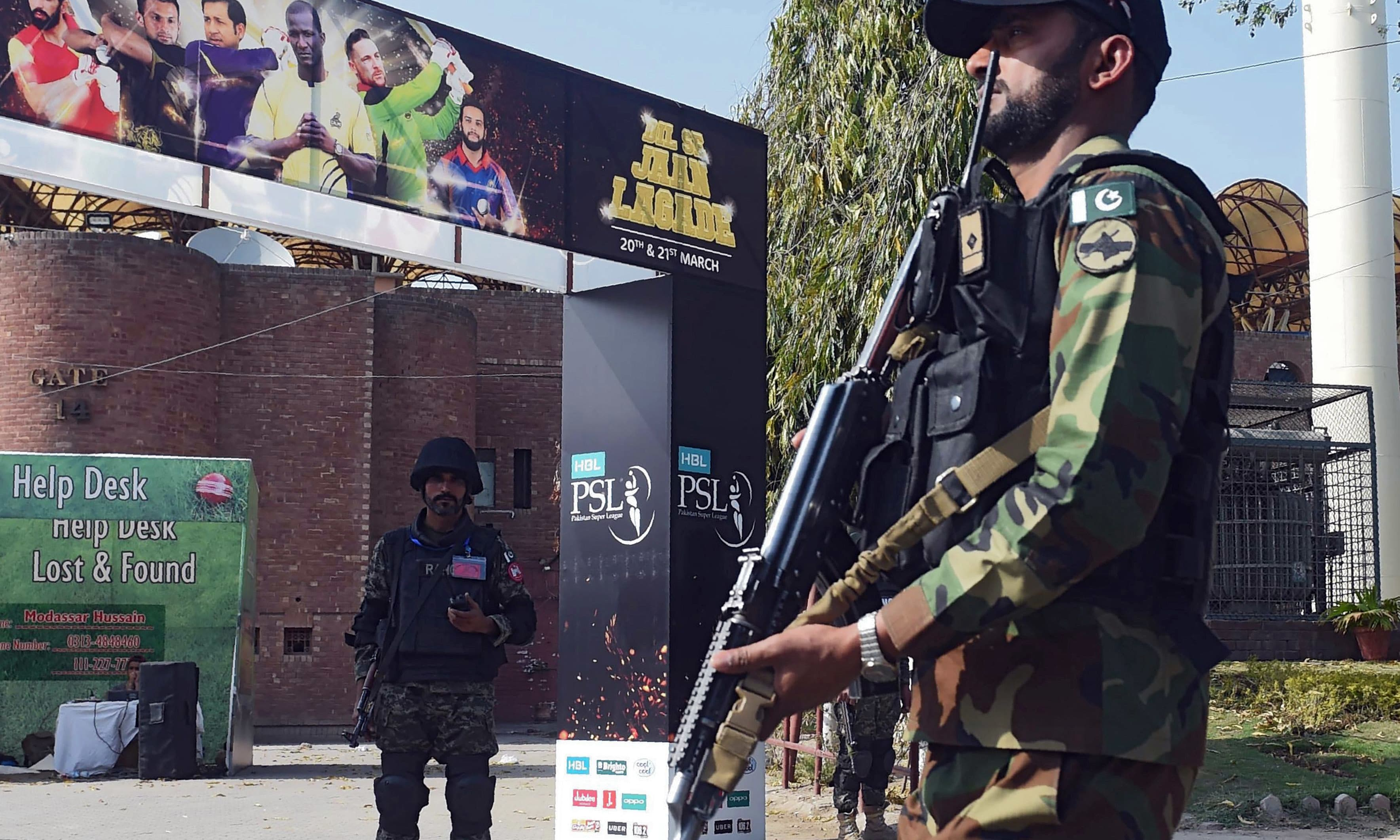 SSG personnel guard outside Gaddafi Cricket Stadium ahead of PSL match. —AFP