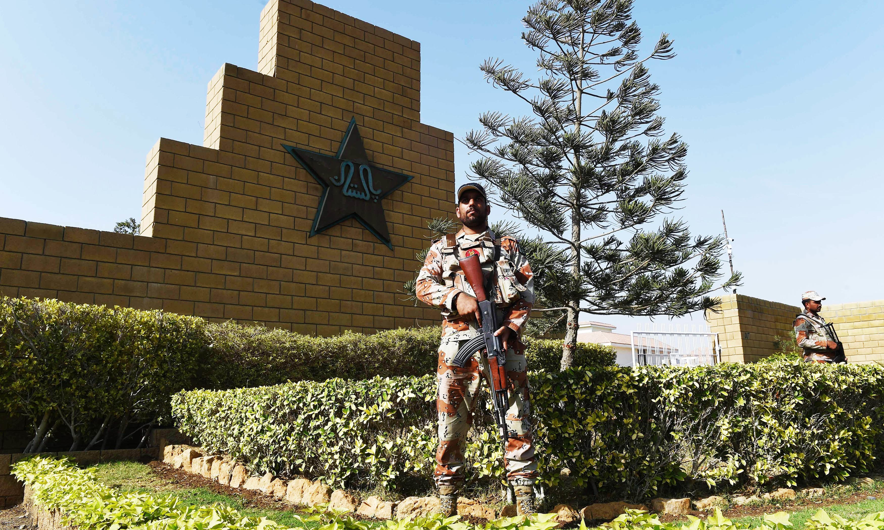 Rangers stand guard outside the National Cricket Stadium for the forthcoming PSL final match. —AFP