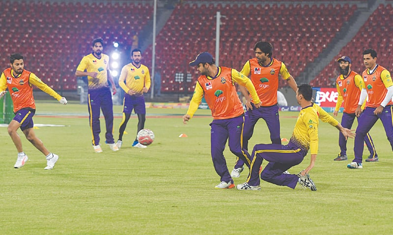 LAHORE: Cricketers of Quetta Gladiators play football during a training session under lights at the Gaddafi Stadium on Monday.—M.Arif/White Star