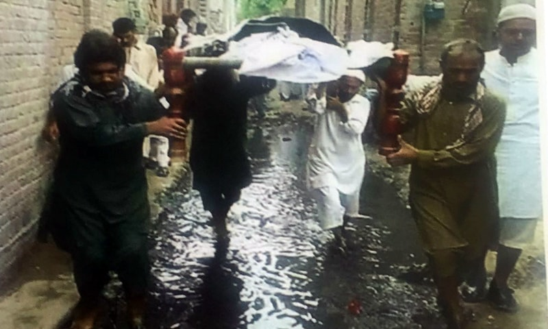 The photo showing a funeral procession passing through sewage water, which the CJP took a notice of on Tuesday. — Photo provided by author