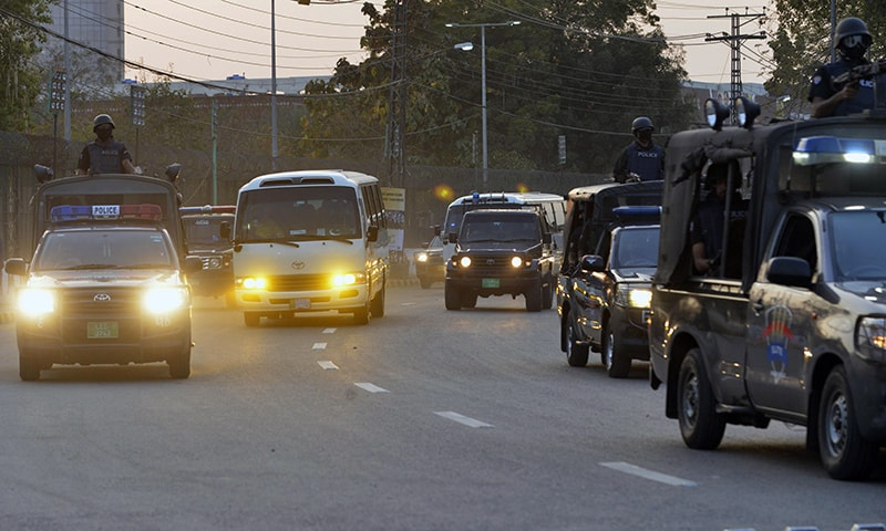 Police escort vehicles carry cricketers of Quetta Gladiators and Peshawar Zalmi teams as they arrive at the Gaddafi Cricket Stadium on Monday. — AFP
