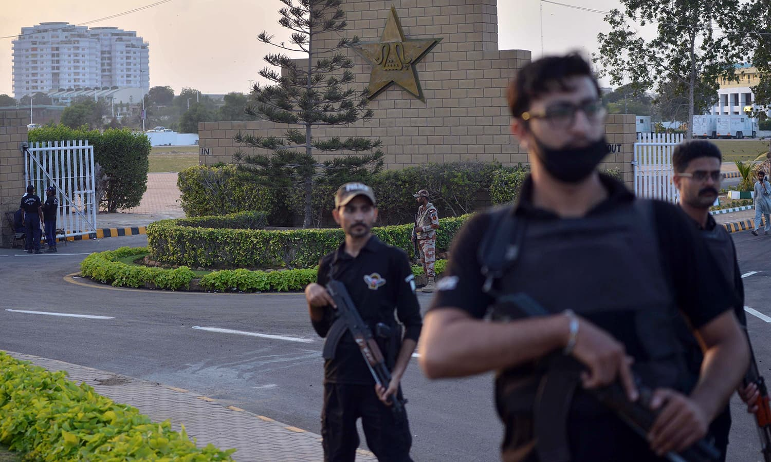 Policemen stand guard outside the National Cricket Stadium on Tuesday. — AFP