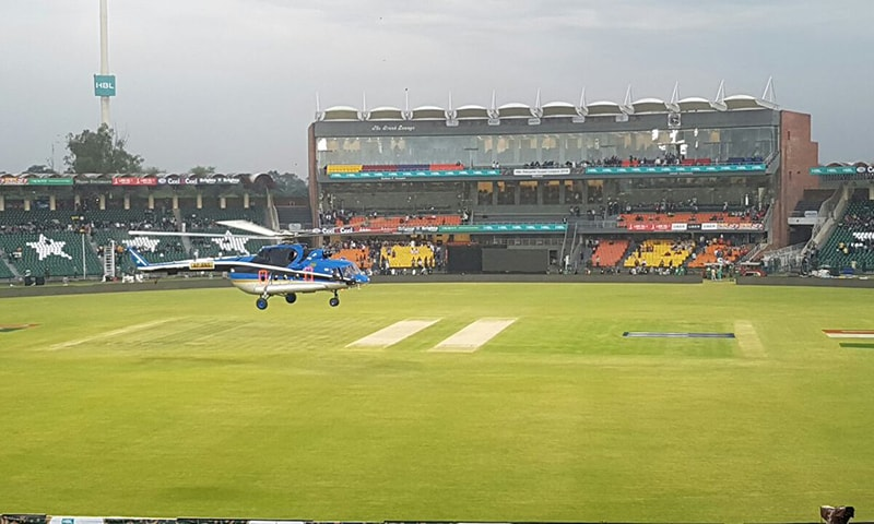 A chopper helps dry out the wet Gaddafi Stadium outfield — PSL