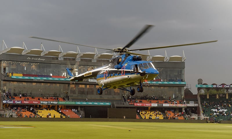 A Punjab province helicopter dries the cricket ground after rain at Gaddafi Stadium — AFP