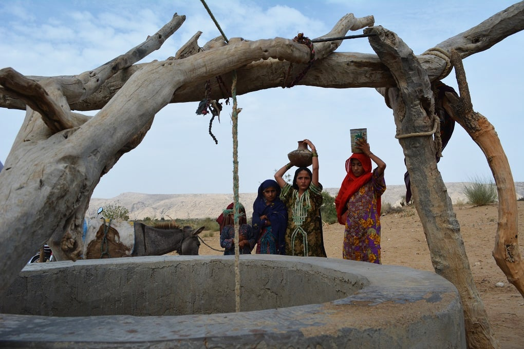 Young girls at a well in a remote village near Thano Bula Khan in Jamshoro District near Karachi. Kohistan is an arid region that has suffered severe droughts for many years. Photo by author.