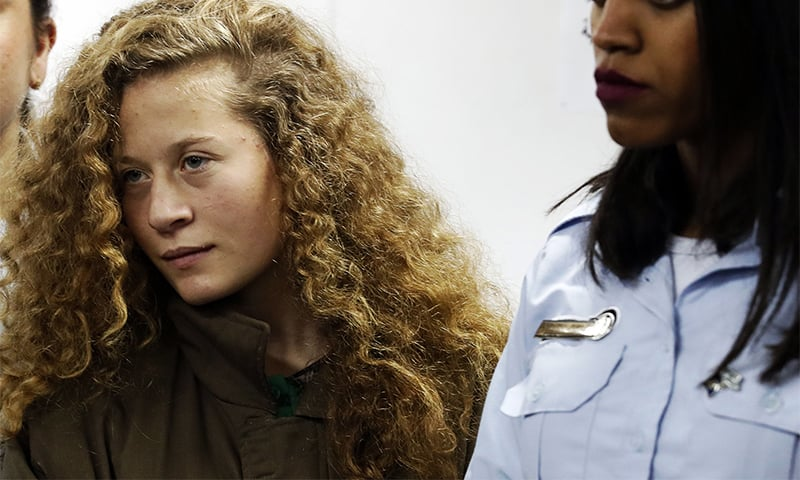 In this file photo taken on December 28, 2017 Palestinian Ahed Tamimi appears at a military court at the Israeli-run Ofer prison in the West Bank village of Betunia. ─ AFP