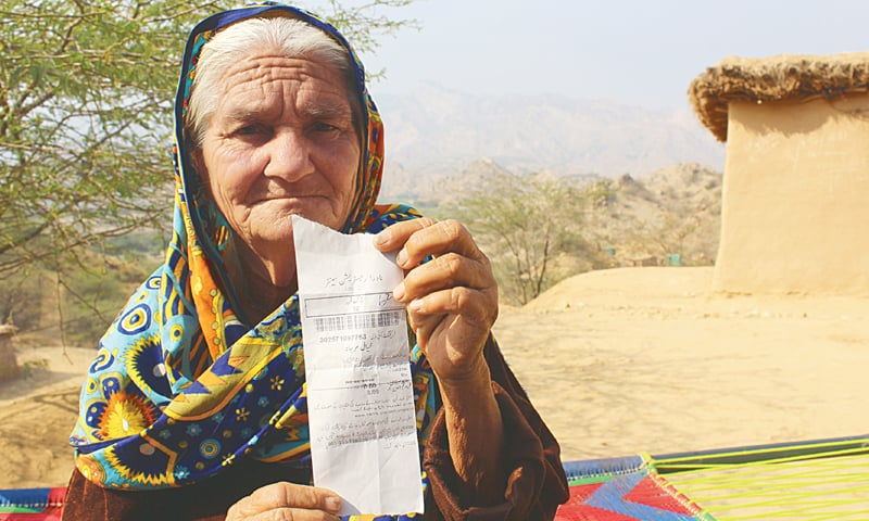KHAYAL Marjana showing her CNIC token.—Photo by writer