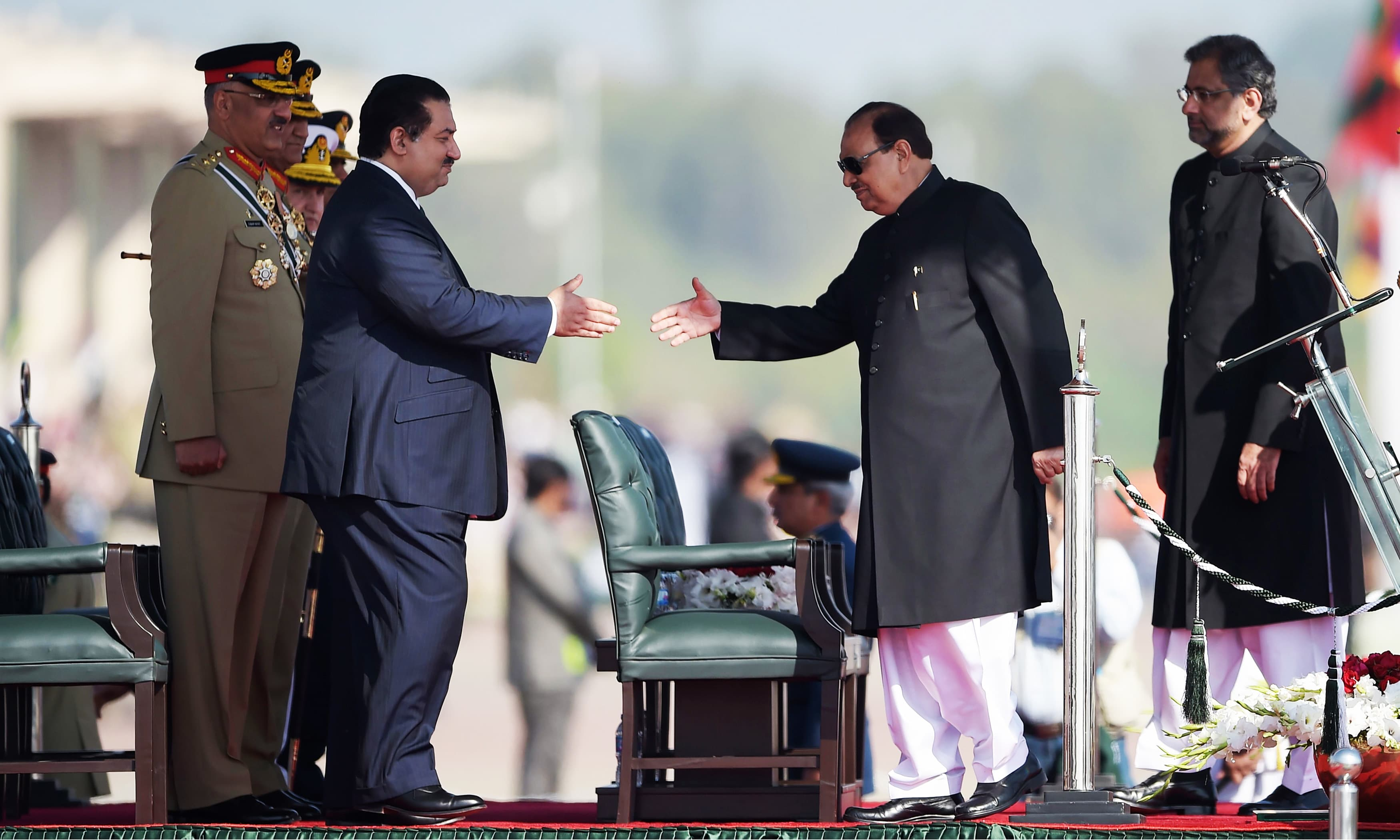 President Mamnoon Hussain shakes hands with Defence Minister Khurram Dastgir. —AFP