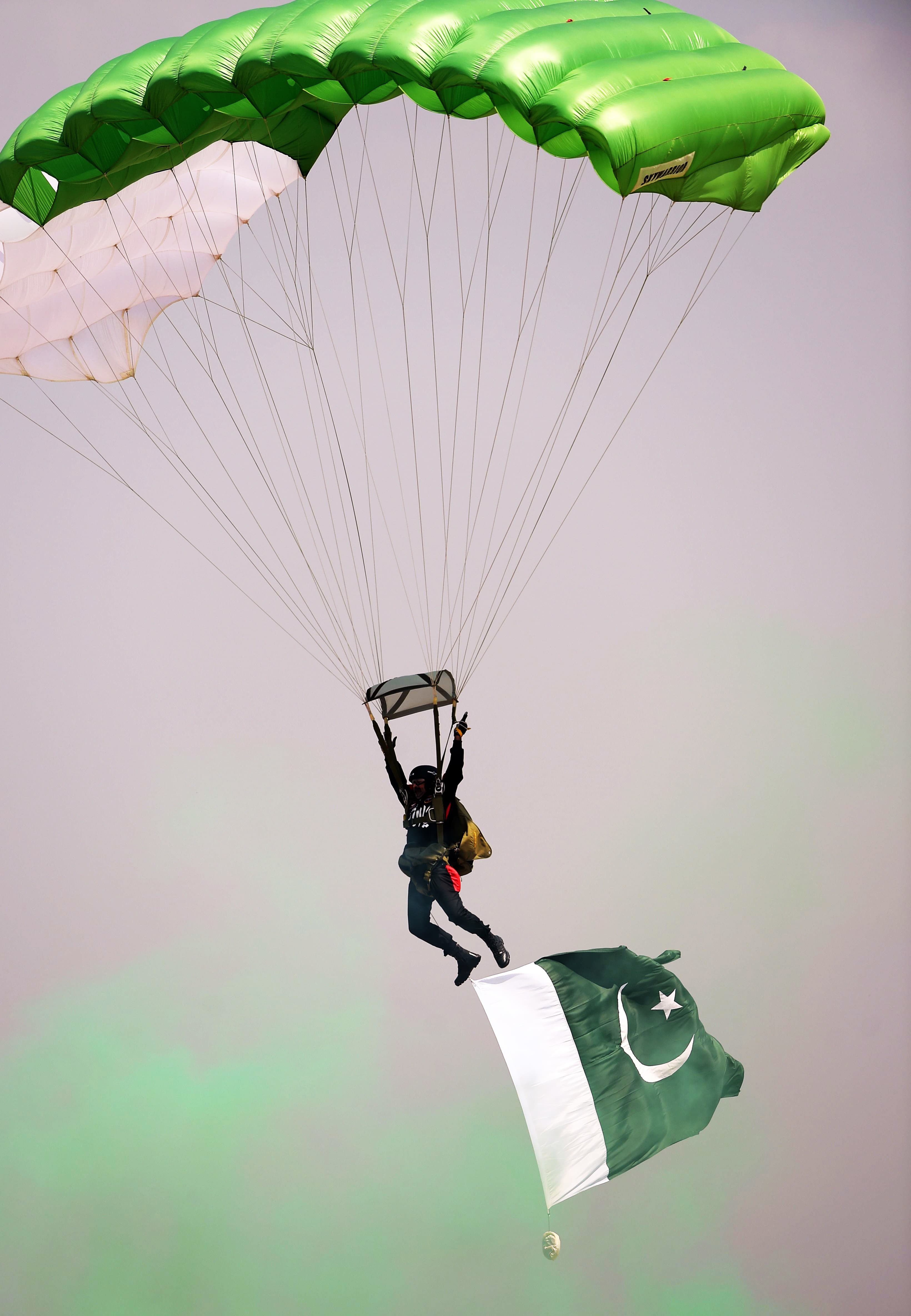 A paratrooper performs during the Pakistan Day military parade. —AFP