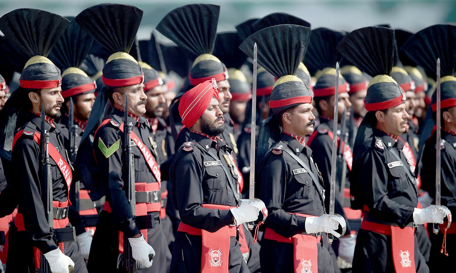 Pakistani border soldiers march past during the Pakistan Day military parade in Islamabad. ─AFP