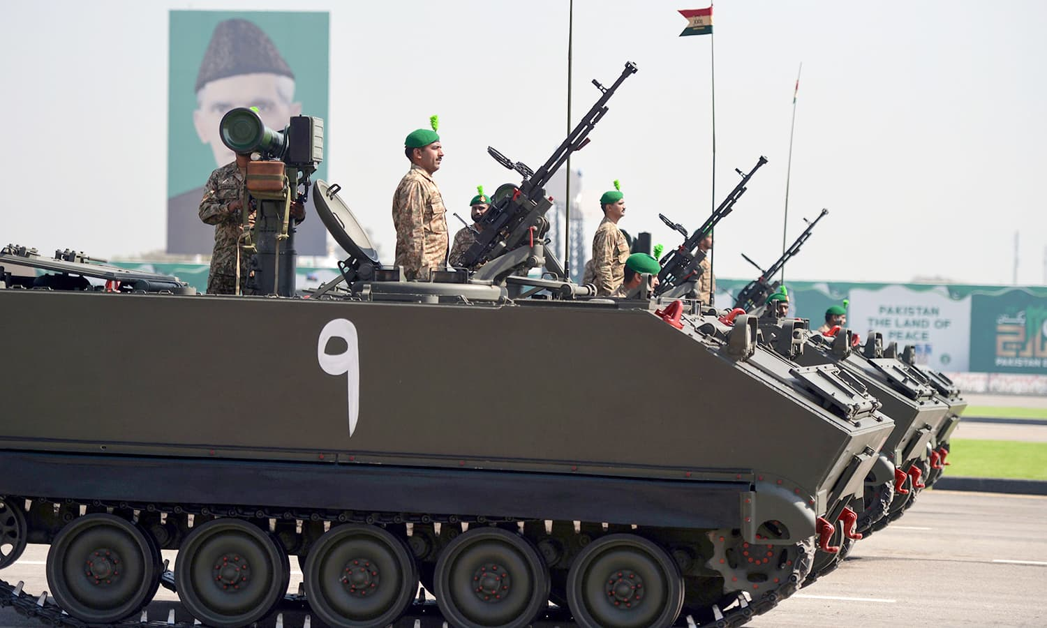 Tank crews steer their vehicles during the Pakistan Day military parade in Islamabad. ─AFP