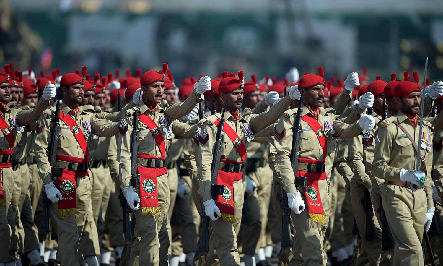 Pakistani soldiers march past during the Pakistan Day military parade in Islamabad. ─AFP