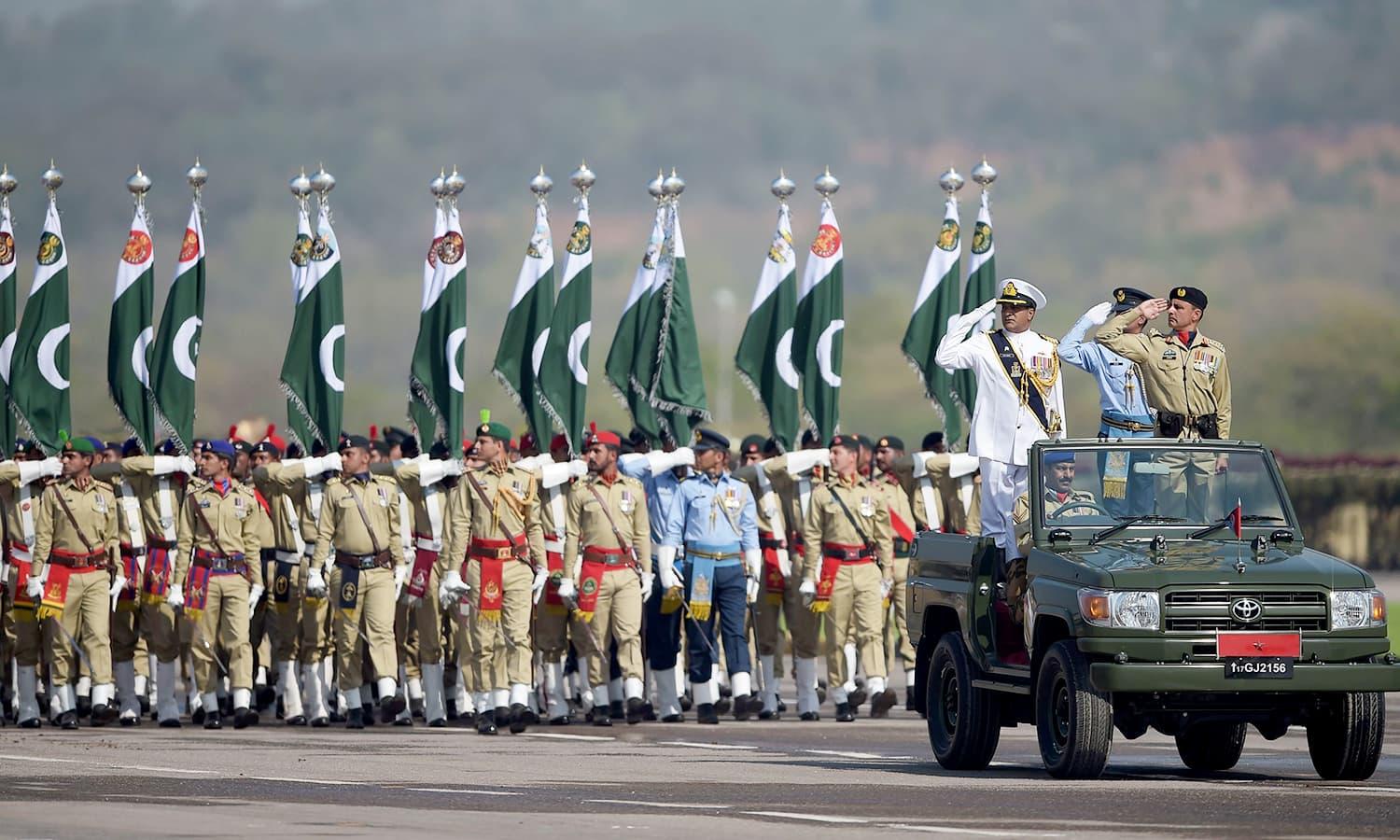 Armed forces soldiers march past during the Pakistan Day military parade in Islamabad. ─AFP