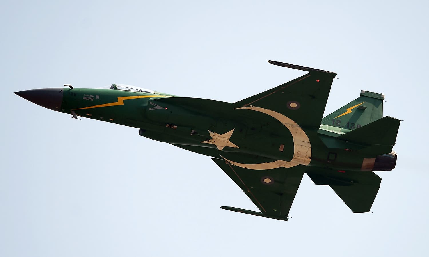 A Pakistani JF-17 thunder aircraft fly by during the Pakistan Day military parade in Islamabad. ─AFP
