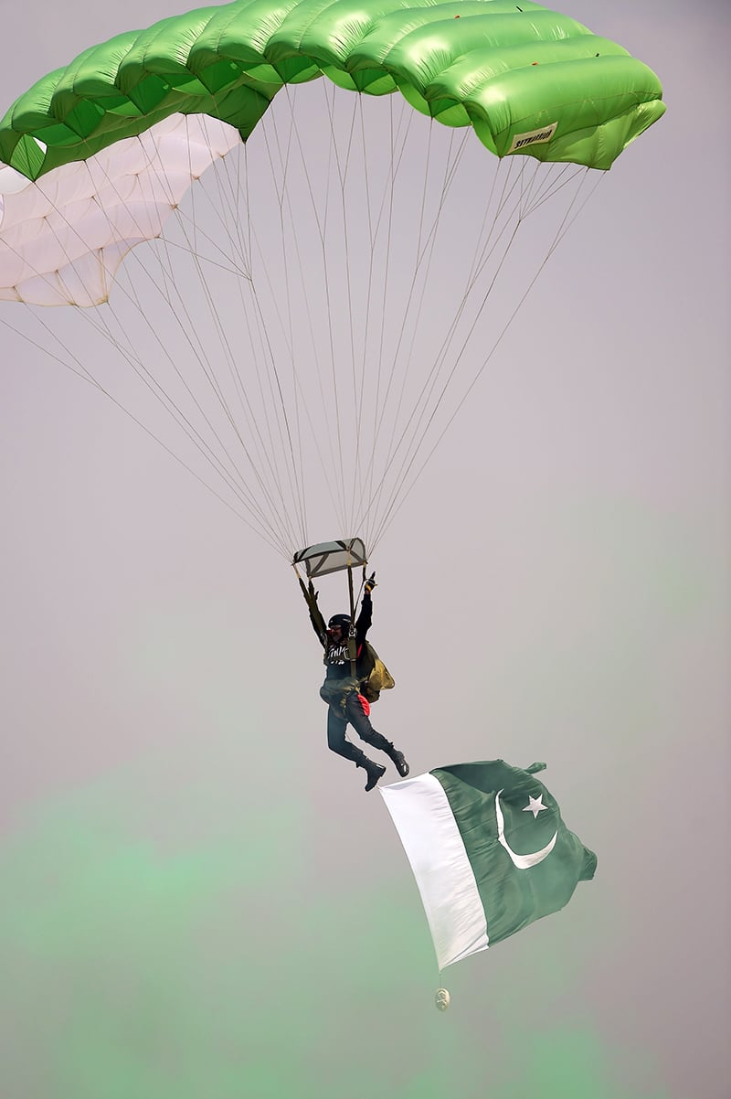 A trooper performs during the Pakistan Day military parade in Islamabad. ─AFP