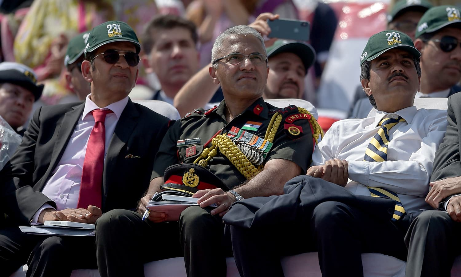 An Indian delegation including Indian Army officer Sanjay Vishwasrao watch the Pakistan Day military parade in Islamabad. ─AFP