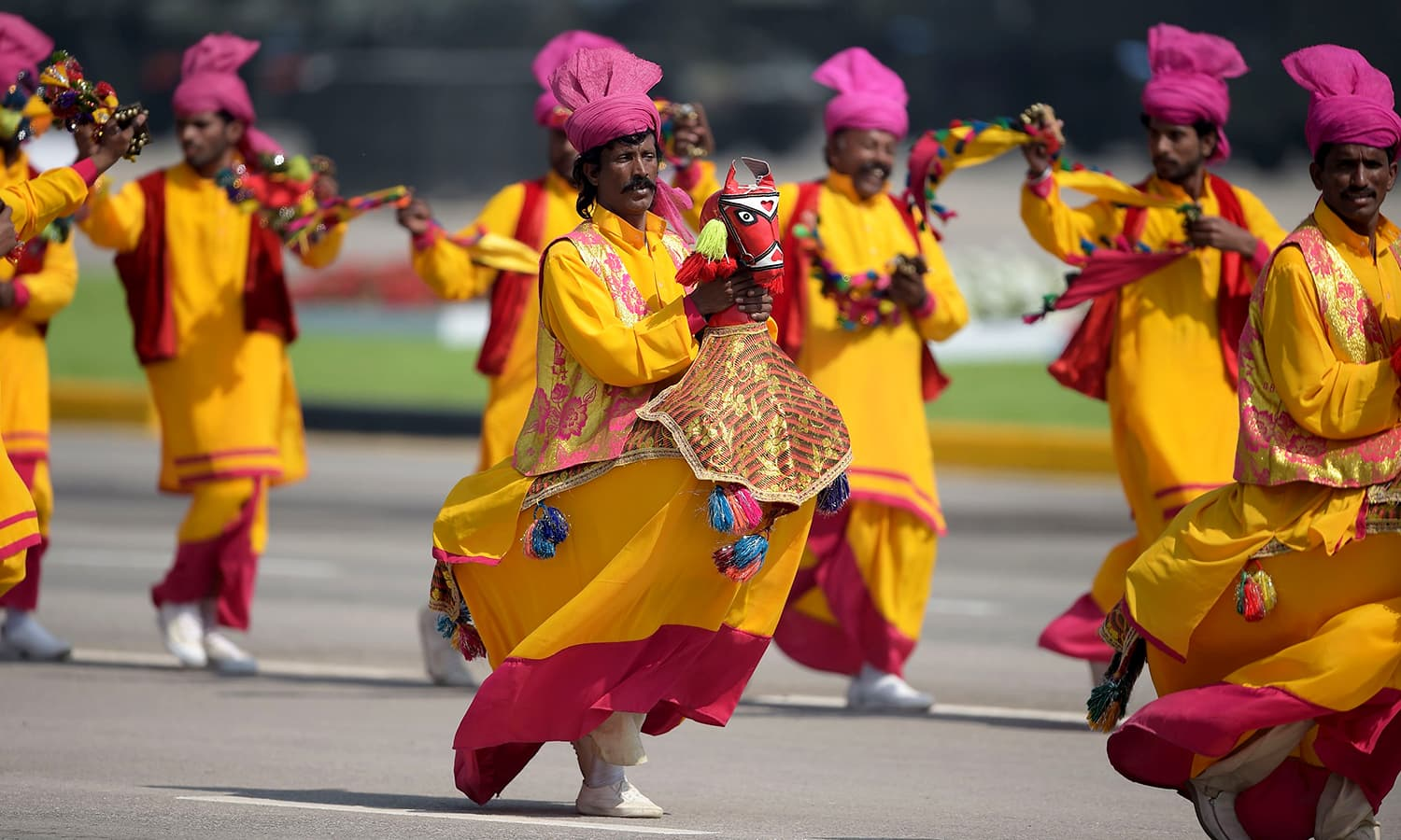 Pakistani artists perform during a Pakistan Day military parade in Islamabad. ─AFP