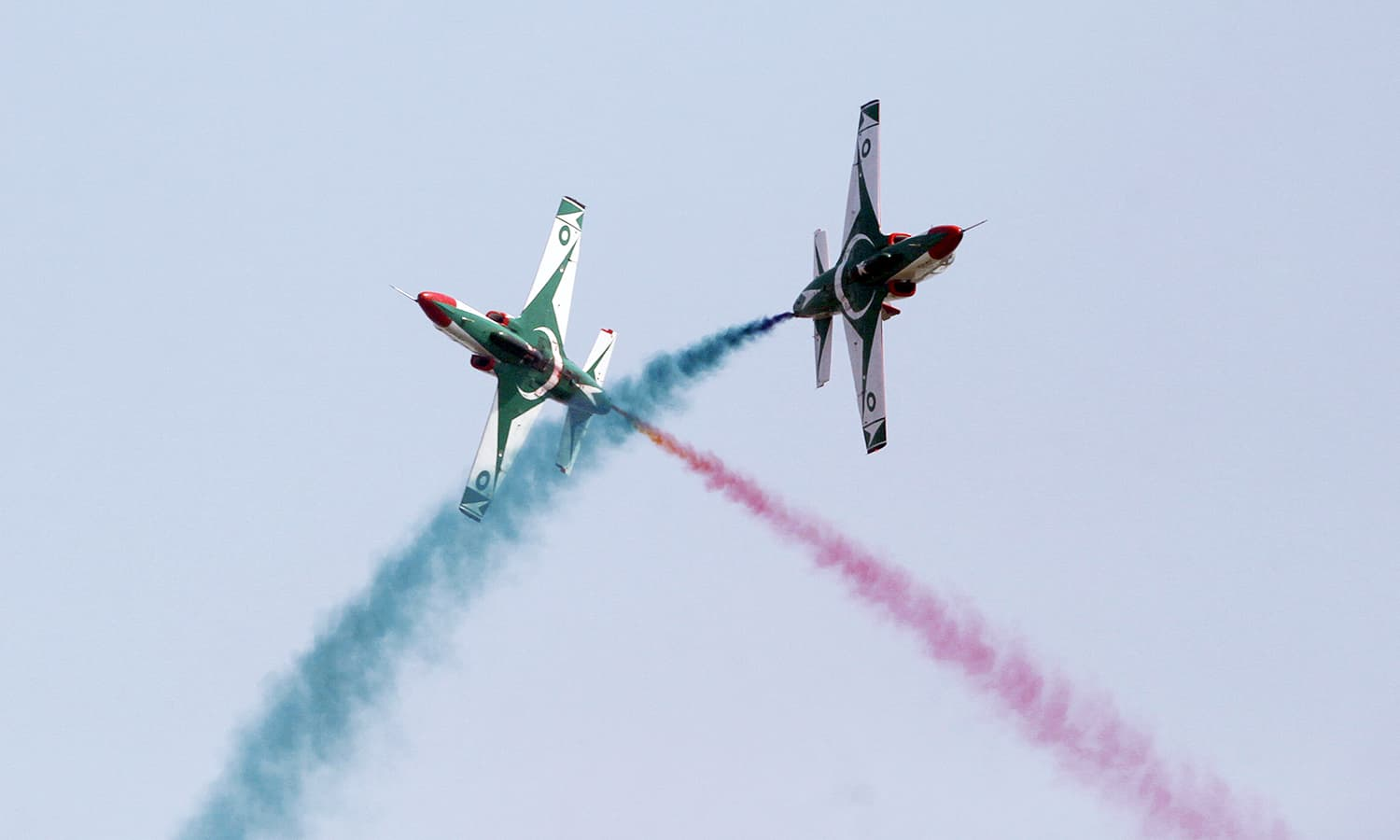 Pakistani Air Force jets demonstrate an aerobatic performance during a military parade in Islamabad. ─AP