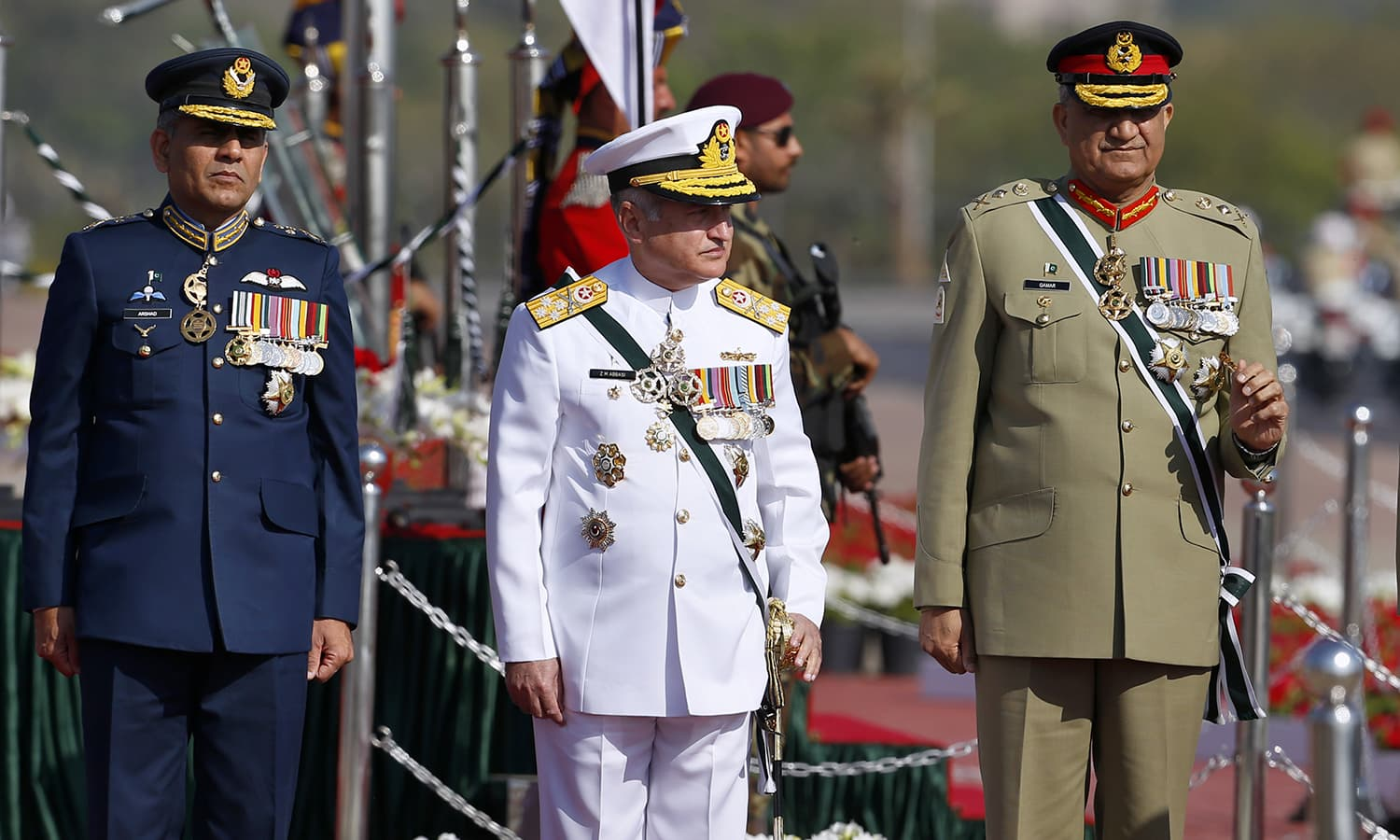 Pakistan Army Chief Qamar Javed Bajwa, Naval Chief Admiral Zafar Mahmood Abbasi, and a top officer of Pakistan Air Force arrive for a military parade in Islamabad. ─AP
