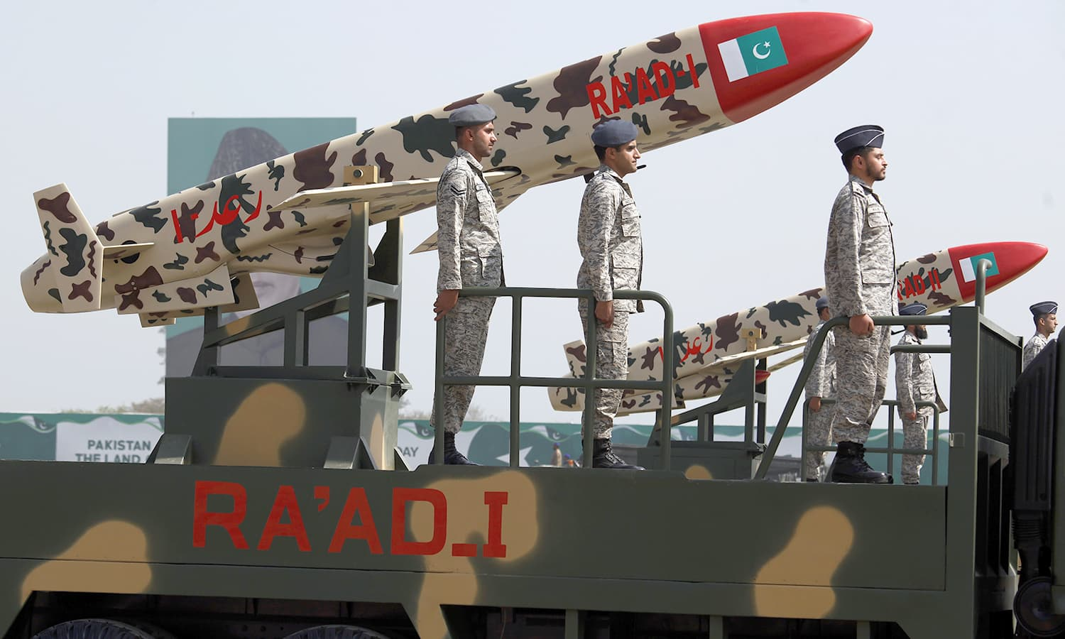 Soldiers stand beside Ra'ad I missiles on display during the Pakistan Day military parade in Islamabad. ─AP