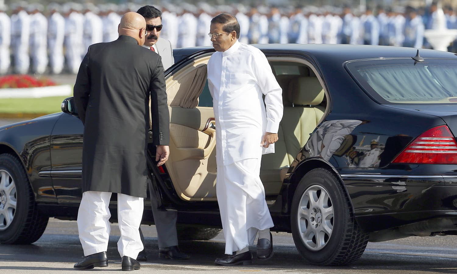 Visiting Sri Lankan President Maithripala Sirisena arrives to attend the Pakistan Day military parade in Islamabad. ─AP