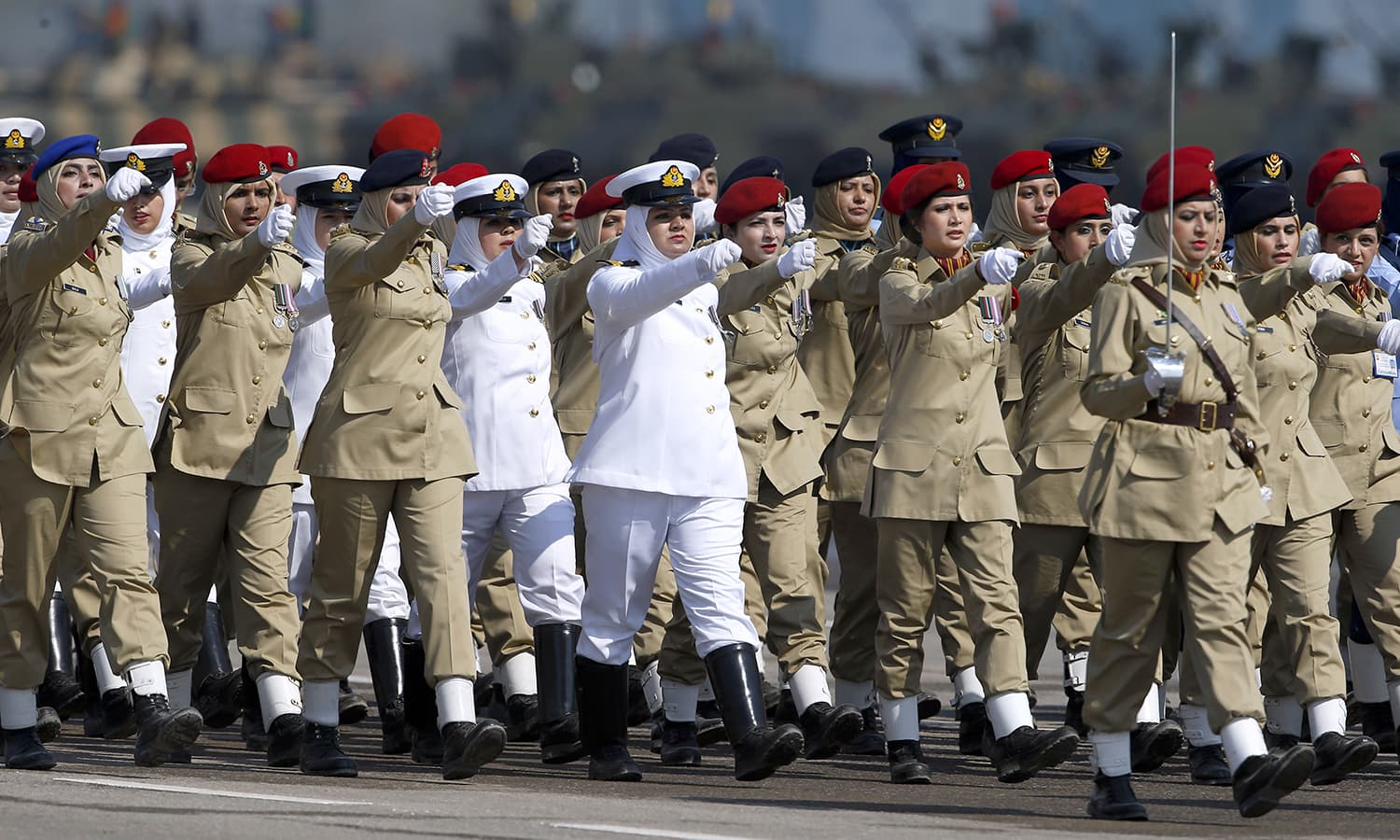 Female soldiers of Pakistan Army march during the Pakistan Day military parade in Islamabad. ─AP
