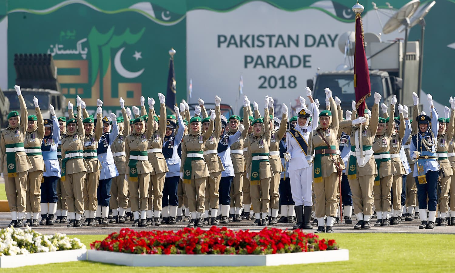 Female soldiers of the Pakistan Army chant 'Long Live Pakistan' during the Pakistan Day military parade in Islamabad. ─AP