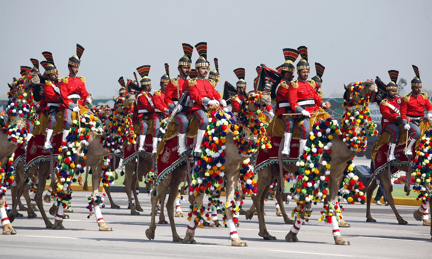 Pakistan's presidential guards ride on camels during the Pakistan Day military parade in Islamabad. ─AP