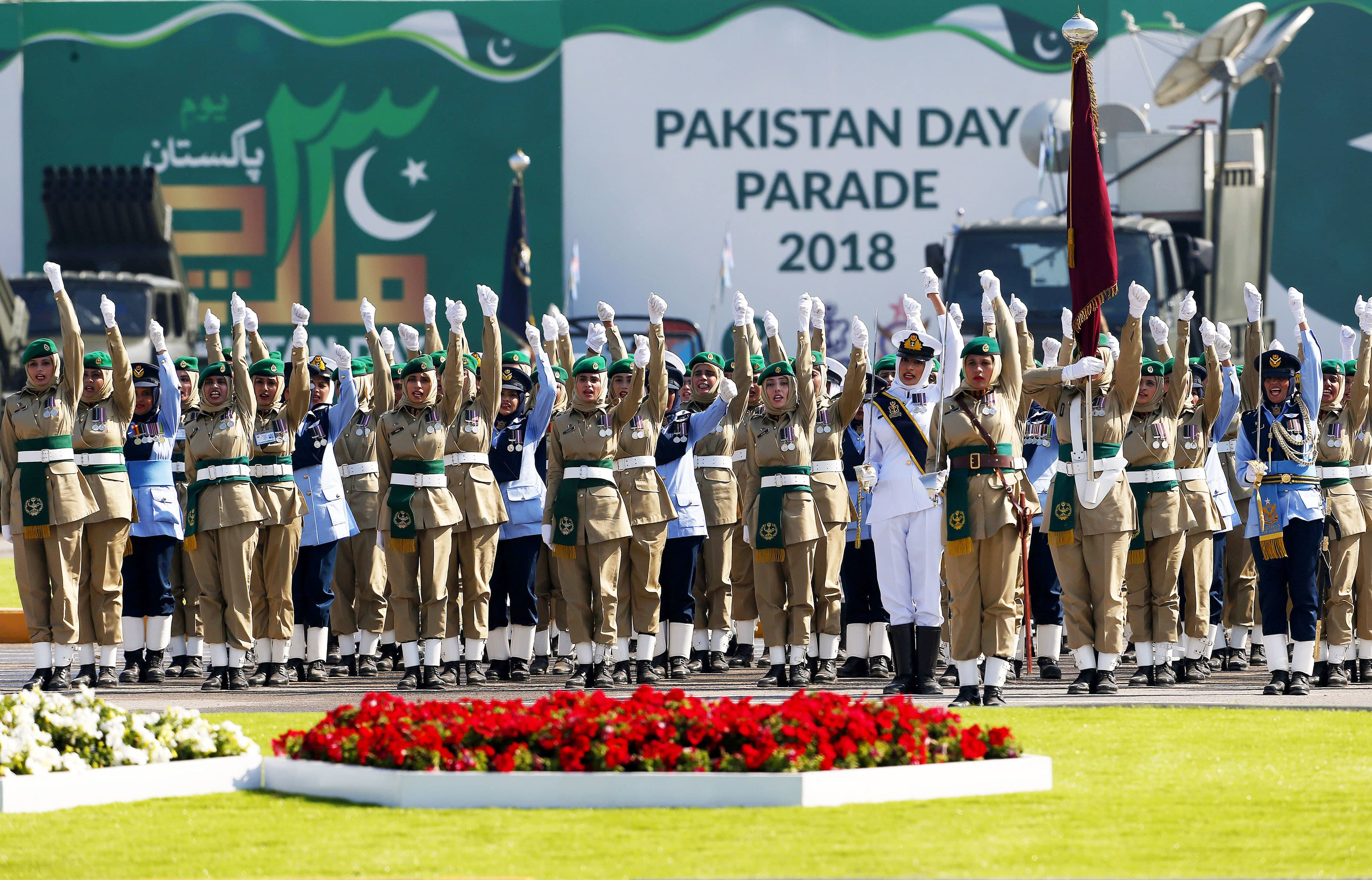 Female soldiers of the Pakistan Army chant 'Long Live Pakistan' during a military parade in Islamabad, Pakistan, Friday, March 23, 2018. Pakistanis celebrated their National Day with a military parade in the capital, Islamabad, showcasing short- and long-range missiles, tanks, jets, drones and other hardware. Troops, including female soldiers, marched past a stand with political and military leaders. (AP Photo/Anjum Naveed) — Copyright 2018 The Associated Press. All rights reserved.