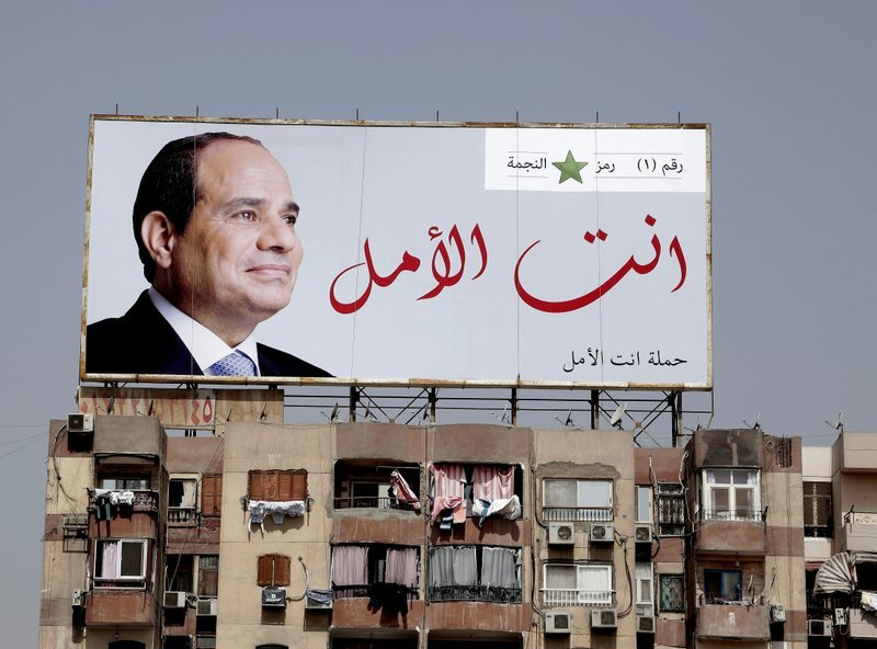"""In this March 19 photo, an election banner for Egyptian President Abdel-Fattah el-Sissi hangs on top of a residential building with Arabic that reads, """"You are the hope,"""" on the ring road in Cairo, Egypt. — AP"""