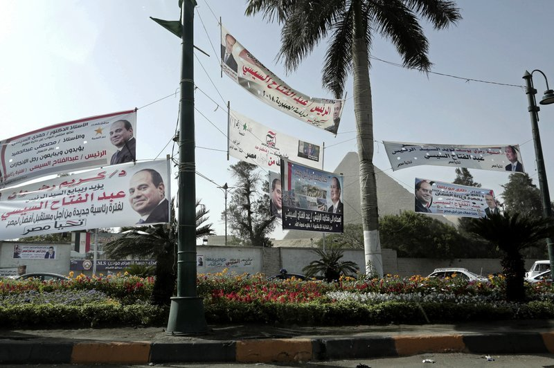 In this March 19 photo, election campaign banners for Egyptian President Abdel-Fattah el-Sissi hang near the Giza Pyramids in Egypt. ─ AP