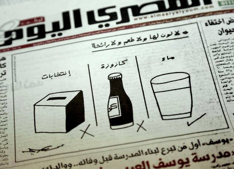 """In this March 18 photo, a cartoon by artist Amr Selim in Al Masry Al Youm Newspaper about the presidential election with Arabic from right to left that reads, """"It has no color, no taste, no smell - water, soft drink, election,"""" in Cairo, Egypt. ─ AP"""
