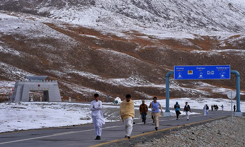 This file photo taken on September 29, 2015 shows Pakistani tourists leaving the Khunjerab Pass, the world's highest paved border crossing at 4,600 metres above sea level, near the Pakistan-China border. — AFP