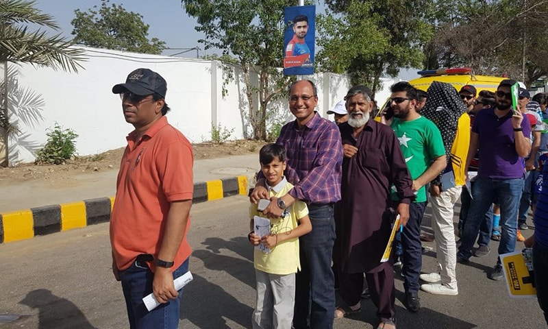 PPP MPA Saeed Ghani stands in line with his son to enter NSK.