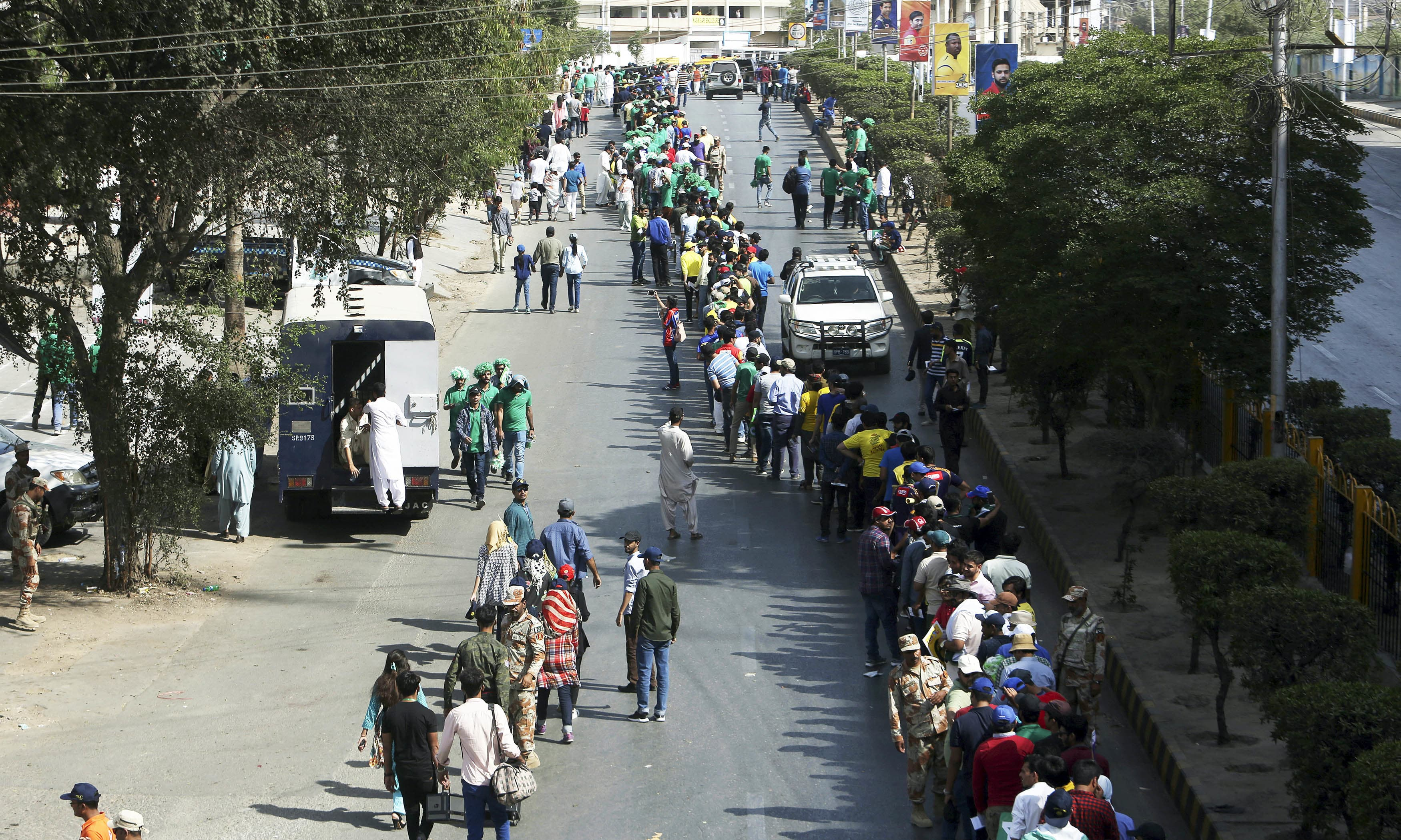 Cricket fans stand in a long queue to enter the National stadium. —AP