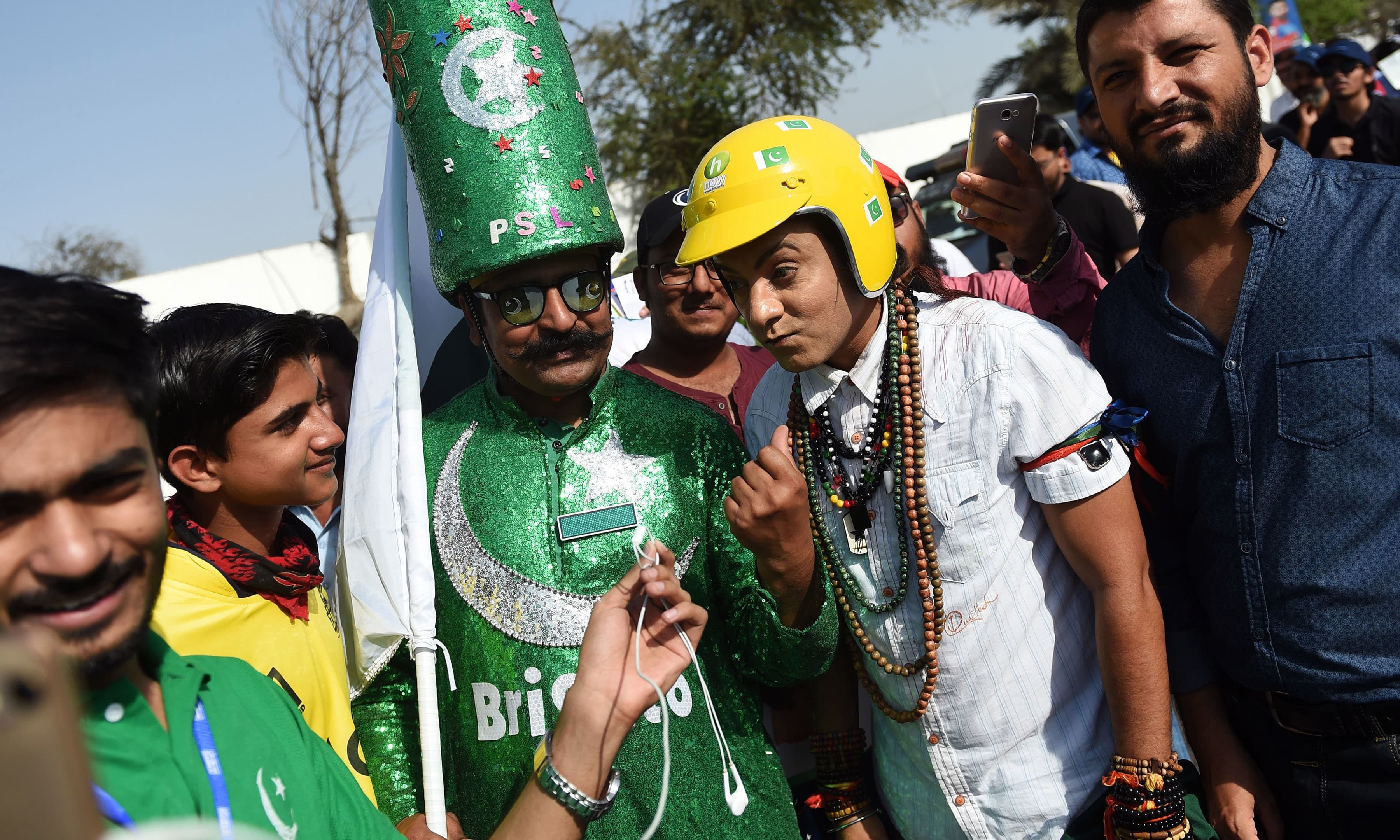 Cricket fans arrive at the National Cricket Stadium in Karachi. —AFP