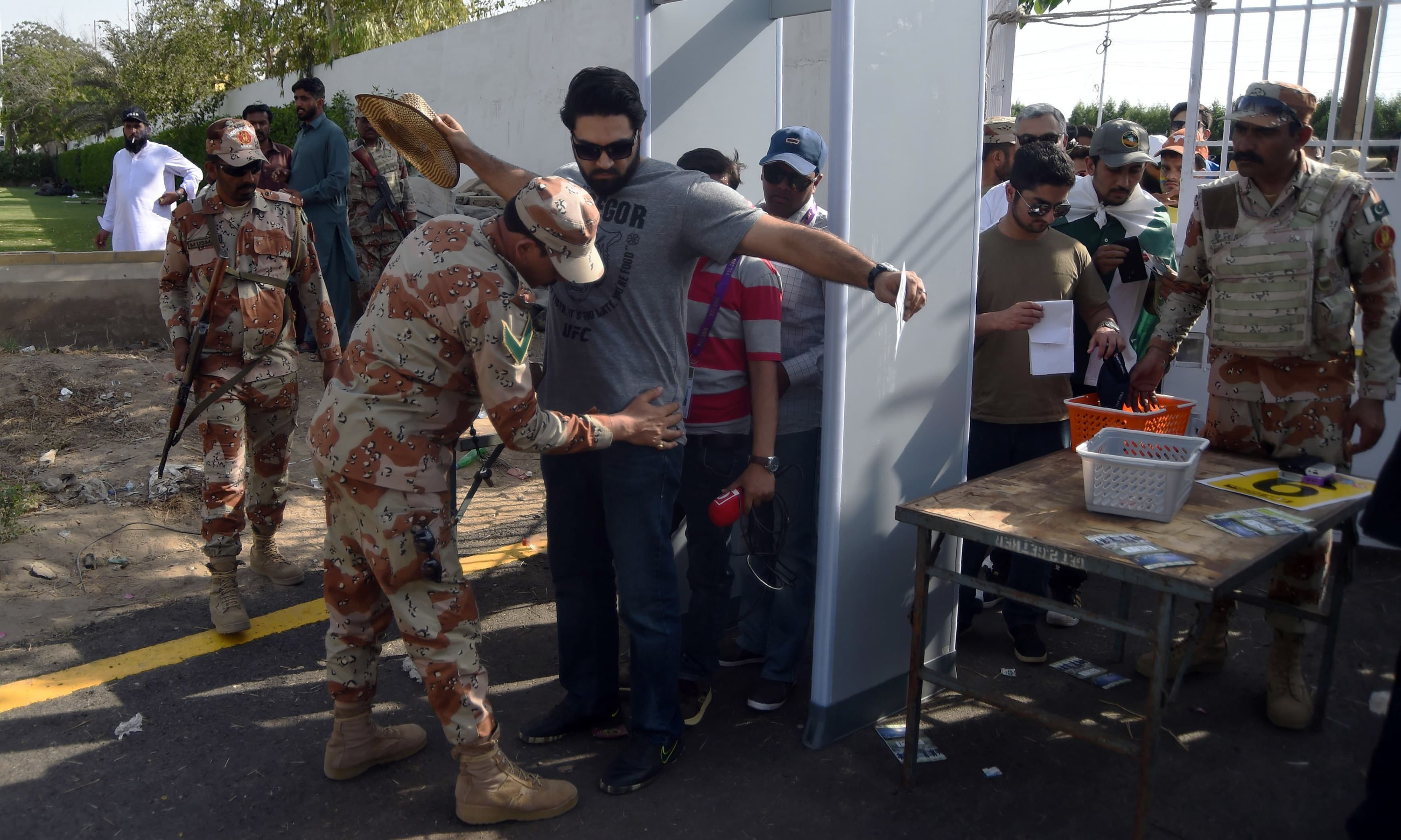 Rangers personnel check cricket fans before entering the National Cricket Stadium. —AFP